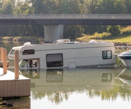 Boat launching fail plunges RV into New York state canal