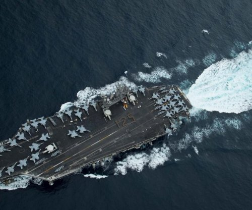 U.S. strike group enters South China Sea as China deploys aircraft carrier