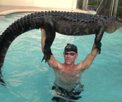 Rescuer wrestles 'mellow' alligator in Florida swimming pool