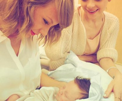 Taylor Swift meets Jaime King's baby Leo -- her new godson