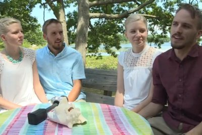 Identical twin brothers marrying identical twin sisters in Michigan