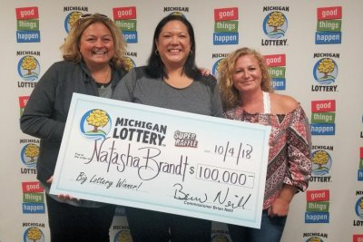 Raffle-ticket-bought-with-lotto-winnings-earns-woman-$100,000