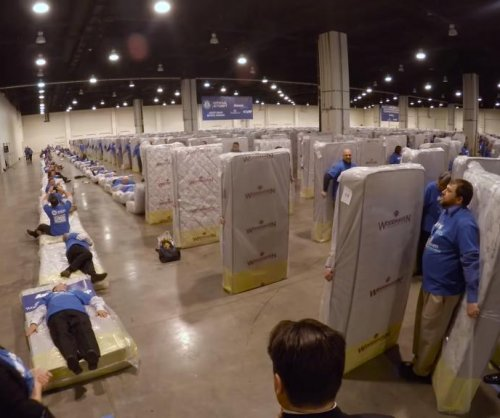 Guinness record for human mattress dominoes broken with 1,200 participants