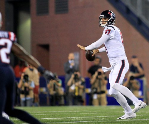 Houston Texans' Brock Osweiler let his eyes inticate his intentions