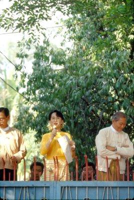 Suu Kyi, U.S. visitor go on trial