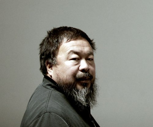 Artist Ai Weiwei poses as drowned refugee toddler to protest immigration crisis