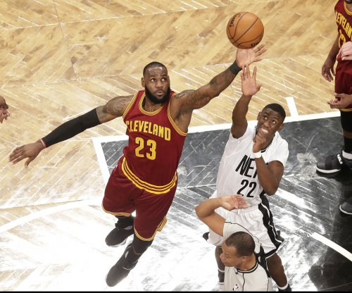 Kyrie Irving, LeBron James propel Cleveland Cavaliers past Brooklyn Nets
