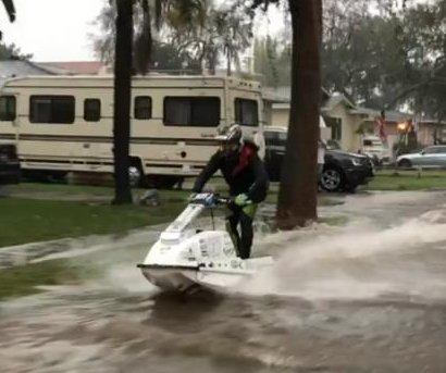 California man takes jet ski for a spin on flooded Fullerton street