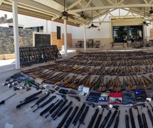 Man jailed after police find 553 guns in 2 LA-area homes