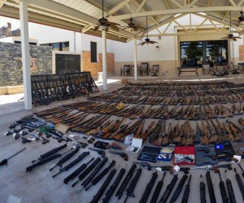 Man jailed after police find 553 guns in 2 LA-area homes