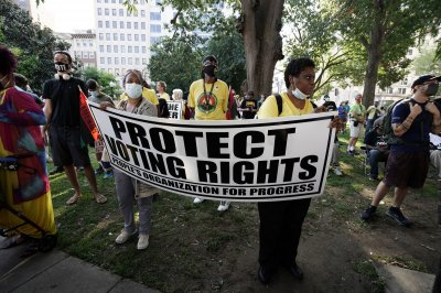 'March on for voting rights' on anniversary of March on Washington