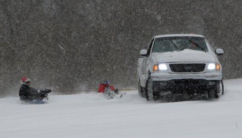 Storm system carries snow, sleet, rain