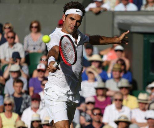 Wimbledon: Federer, Murray advance, meet Friday