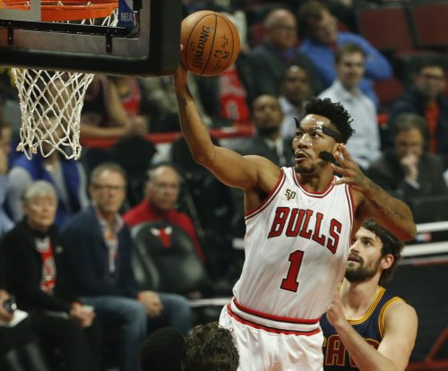 Derrick Rose, Chicago Bulls edge LeBron, Cavaliers in opener