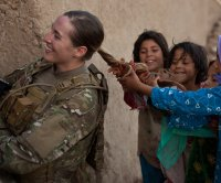 Army formalizes plan to allow women to wear ponytails