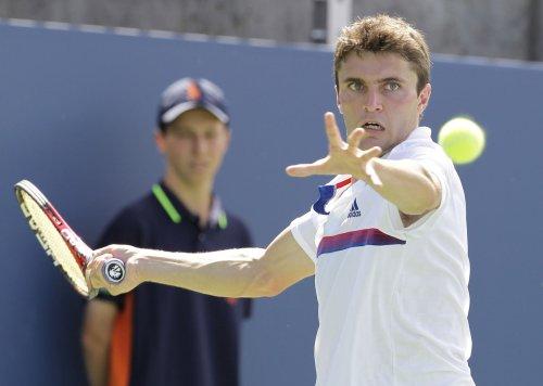 Simon advances at Brisbane International