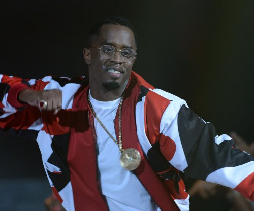 Diddy stumbles during surprise Bad Boy performance at BET awards, hints at 'family' tour