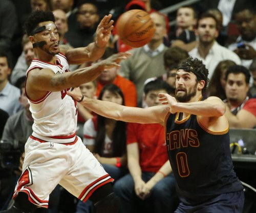 Chicago Bulls' Derrick Rose exits with back, hamstring ailments