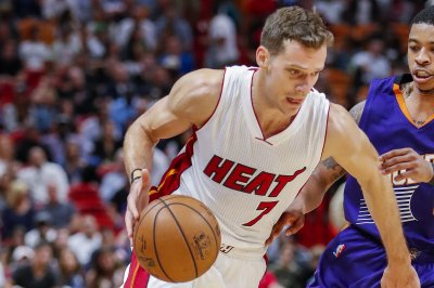 Goran Dragic, Miami Heat keep NBA playoff hopes alive with win over Charlotte Hornets