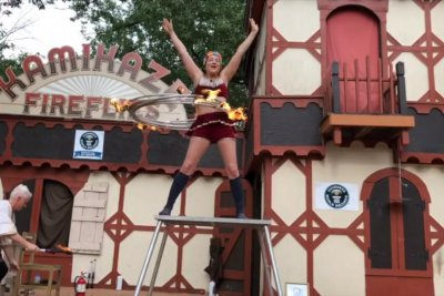 Performer breaks Guinness record with five flaming hula hoops