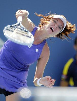 Radwanska advances in three sets in China