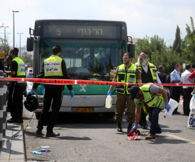 Six Israelis injured in stabbings; Palestinian killed