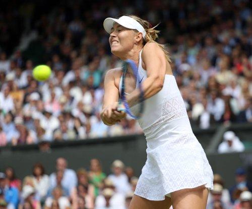 Maria Sharapova, Serena Williams reach Australian Open quarterfinals