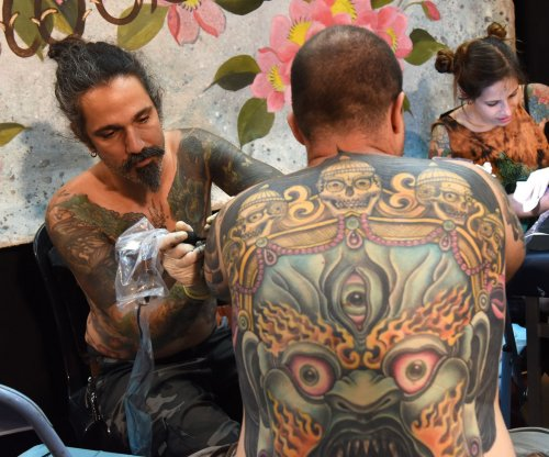 Reason for tattoo permanence may improve methods of removal