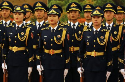 Former Chinese general given suspended death sentence for corruption