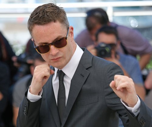 Director Nicolas Winding Refn interested in a Batgirl film: 'Let's get Warner working on it'