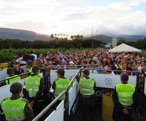 Colombia sends 46 trucks to restock after 120,000 Venezuelans cross border to buy goods