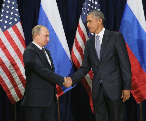 Obama briefly meets Putin while in Peru to talk Ukraine, Aleppo
