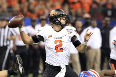In surprise, Oklahoma State's Mason Rudolph edges Baker Mayfield for Johnny Unitas Award