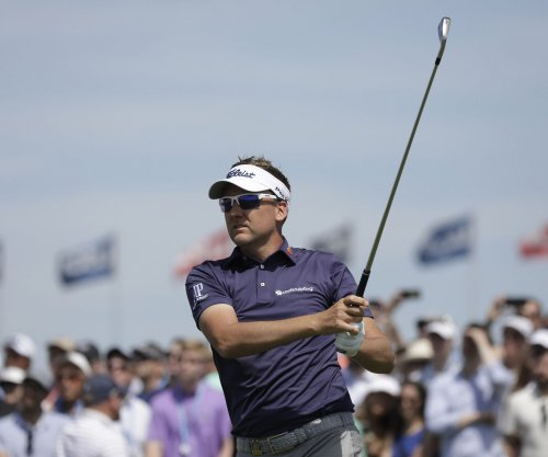 British Open: Ian Poulter hits lucky shot over water, through bunker