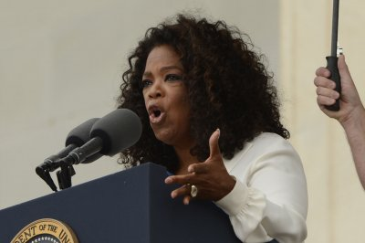 Oprah auction brings in $600,000 for charity