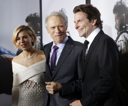 Bradley Cooper recalls his stay at a Holiday Inn Express with 'American Sniper' director Clint Eastwood