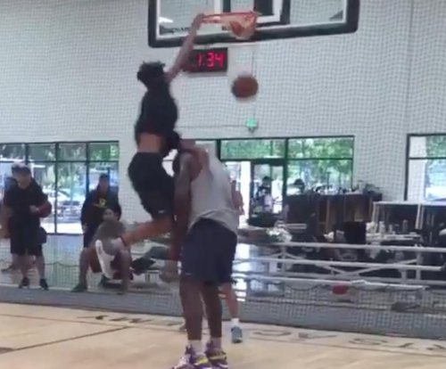 Watch: Shaq lets son Shareef dunk in his face