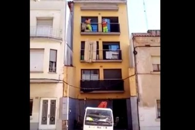 Couch removal from fourth floor balcony fails to go as planned