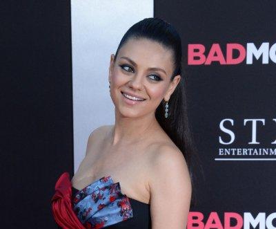 Mila Kunis, Kristen Bell stun at 'Bad Moms' premiere