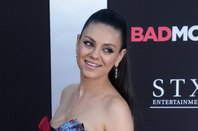 Mila Kunis, Kristen Bell stun at 'Bad Moms' premiere