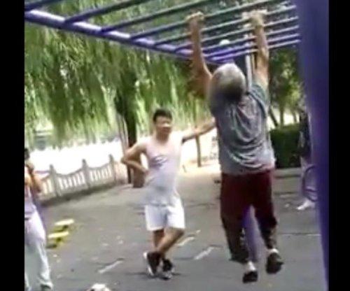 Elderly woman impresses onlookers on monkey bars