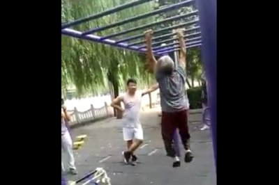 Elderly woman impresses onlookers on monkey bars