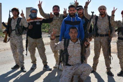 U.S.-backed forces celebrate full liberation of Raqqa