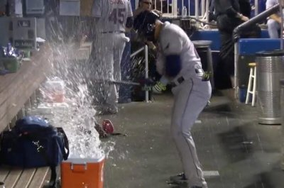 Carlos Gomez takes out frustration on water cooler at Marlins Park
