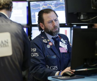 Dow closes 1,000 points lower on COVID-19 fears
