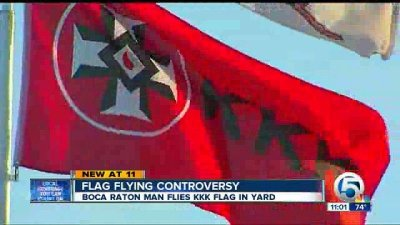 Florida man displays KKK flag and puts 'Members Wanted' sign outside his trailer