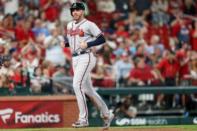Braves beat Cardinals on bases-loaded walk