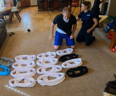 Wife helps husband put on 18 T-shirts in 30 seconds for world record