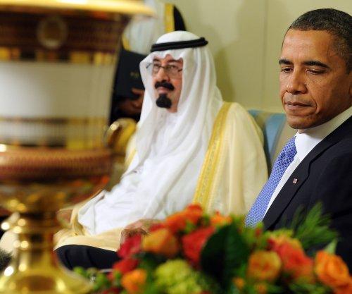 Saudi King Abdullah buried hours after death