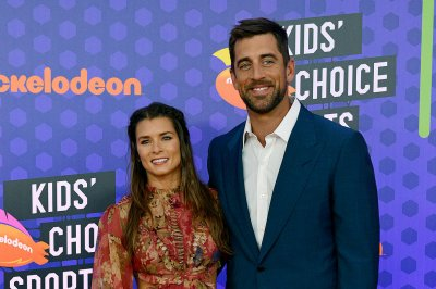 Aaron Rodgers, Danica Patrick enjoy back-to-back public dates, kiss